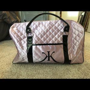 Kim Kardashian pink quilted duffle bag